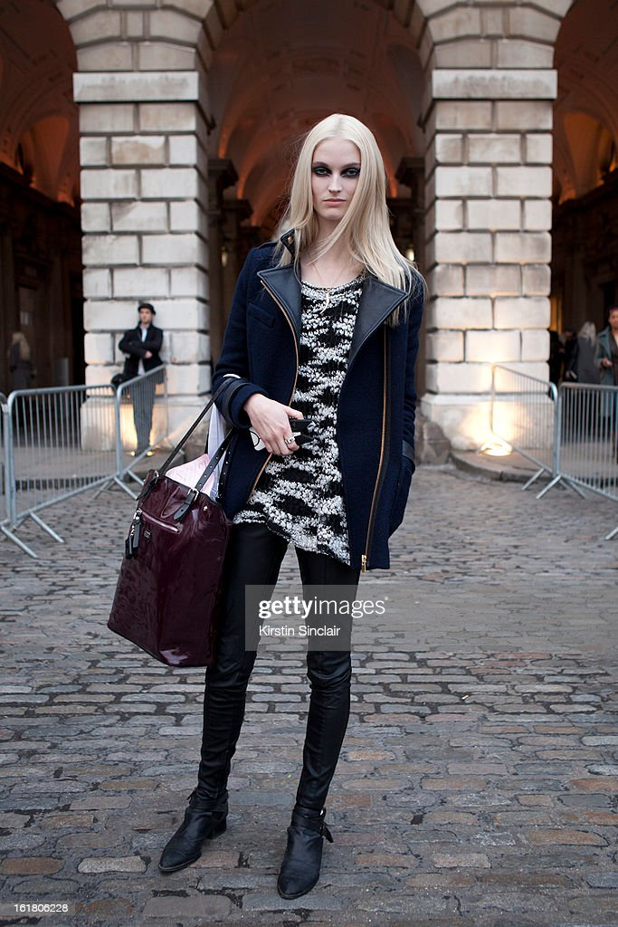 Helena Greyhourse model wearing a Maje jacket, Alexander Mcqueen bag, Jeffrey Campbell shoes, Topshop sweater, Asos trousers on day 1 of London Womens Fashion Week Autumn/Winter 2013 on February 15, 2013 in London, England.