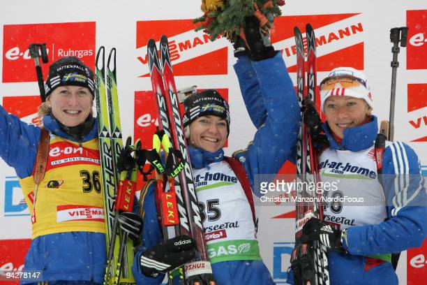 Helena Jonsson of Sweden Anna Carin OlofssonZidek of Sweden and Olga Zaitseva of Russia at the flower ceremony after the women's 75 km sprint on...