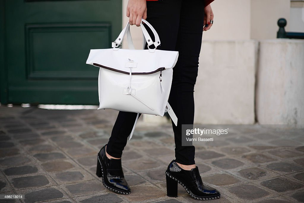 Helena Kibal poses wearing a Kill Today bag and Chanel shoes on September 27 2014 in Paris France