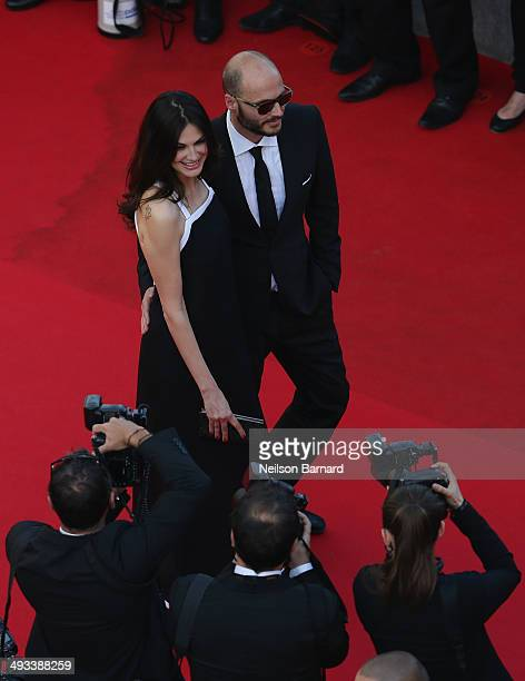 Helena Noguerra and a guest attend the 'Clouds Of Sils Maria' premiere during the 67th Annual Cannes Film Festival on May 23 2014 in Cannes France