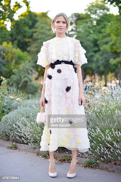Helena Perminova poses wearing a Giambattista Valli dress after the Giambattista Valli show at the Grand Palais on July 6 2015 in Paris France