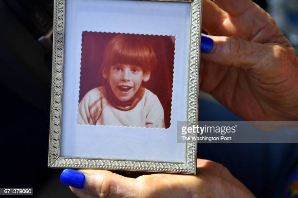Helena Talbot holds a photograph of her son when he was about four or fiveyears old April 20 2017 in Leesburg VA The group home where the now...