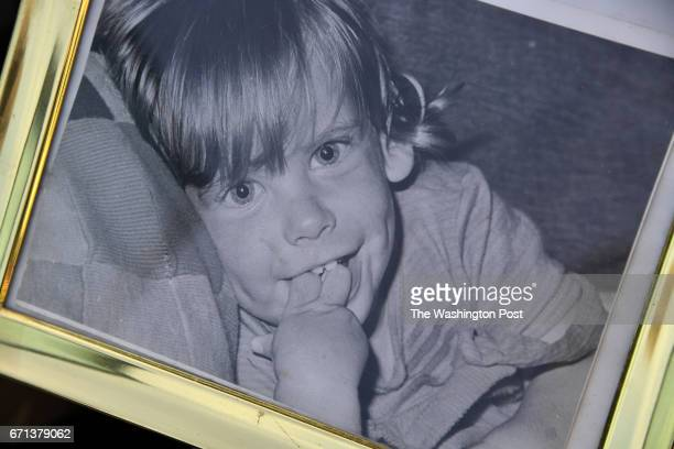 Helena Talbot holds a photograph of her son when he was less than a year old April 20 2017 in Leesburg VA The group home where the now 45yearold who...