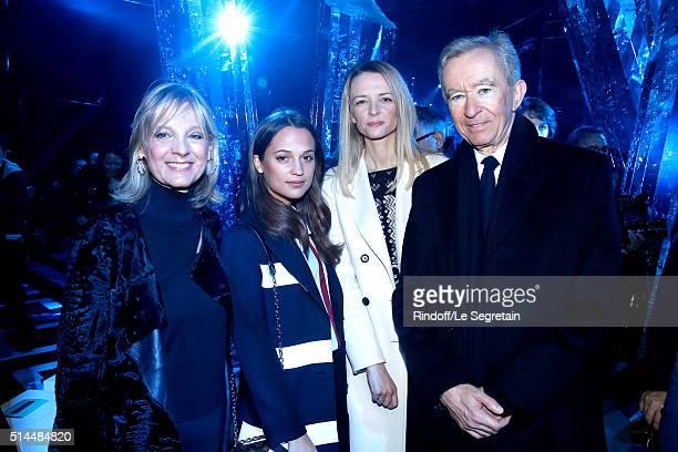 Helene Arnault Alicia Vikander Louis Vuitton's executive vice president Delphine Arnault and Owner of LVMH Luxury Group Bernard Arnault attend the...