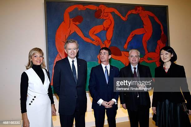 Helene Arnault her husband Owner of LVMH Luxury Group Bernard Arnault French Prime Minister Manuel Valls Hermitage director Mikhail Piotrovsky and...