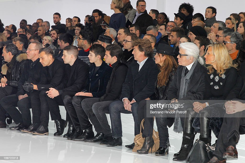 Helene Arnault, Karl Lagerfeld, Narjiss Cluzet, Francois Cluzet, Peter Brant Jr, Harry Brant, Adam Anderson, Theo Hutchcraft, of synthpop group 'The Hurts', Renaud Donnedieu de Vabres and Prince Jaime de Marichalar attend the Dior Homme Men Autumn / Winter 2013 show as part of Paris Fashion Week, at Quartier des Celestins on January 19, 2013 in Paris, France.
