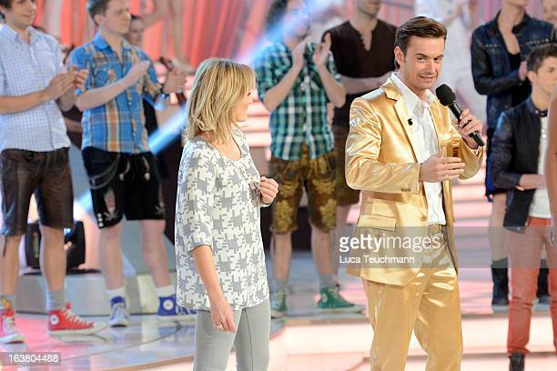 Helene Fischer and Florian Silbereisen talking at 'Das Fruehlingsfest der 100000 Blueten' TVShow at GETEC Arena on March 16 2013 in Magdeburg Germany