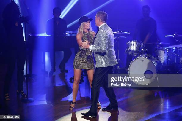Helene Fischer and Joachim Llambi perform on stage during the final show of the tenth season of the television competition 'Let's Dance' on June 9...