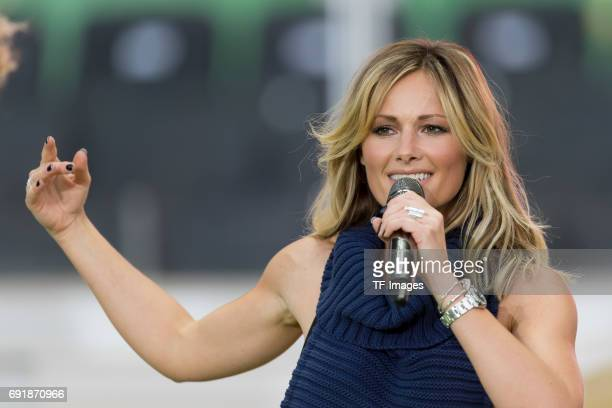 Helene Fischer performs during the half time of the DFB Cup final match between Eintracht Frankfurt and Borussia Dortmund at Olympiastadion on May 27...