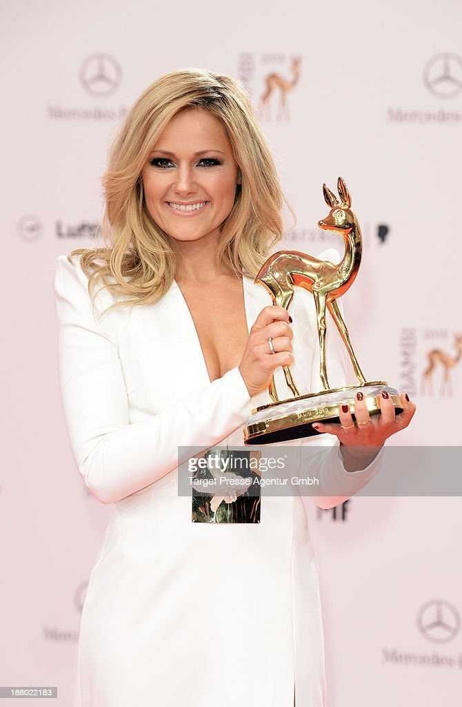 <a gi-track='captionPersonalityLinkClicked' href=/galleries/search?phrase=Helene+Fischer&family=editorial&specificpeople=3628333 ng-click='$event.stopPropagation()'>Helene Fischer</a> poses with the Bambi for best music national at Stage Theater on November 14, 2013 in Berlin, Germany.
