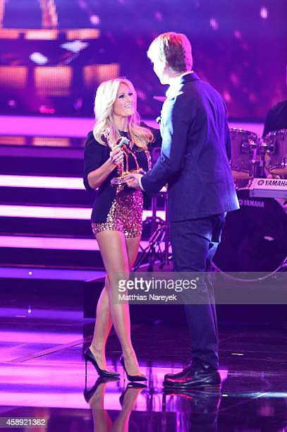 Helene Fischer receives her award from Samu Haber during the Bambi Awards 2014 show on November 13 2014 in Berlin Germany