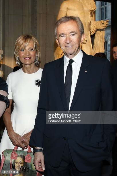 Helene Mercier Arnault and Bernard Arnault attend the 'LVxKOONS' exhibition at Musee du Louvre on April 11 2017 in Paris France