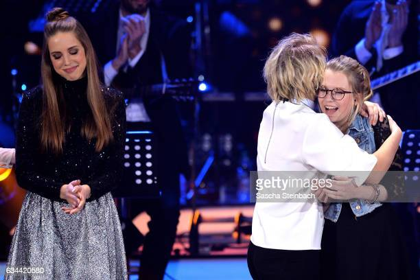 Helene Nissen reacts as Isabella 'Levina' Lueen retires from the 'Eurovision Song Contest 2017 Unser Song' show on February 9 2017 in Cologne Germany