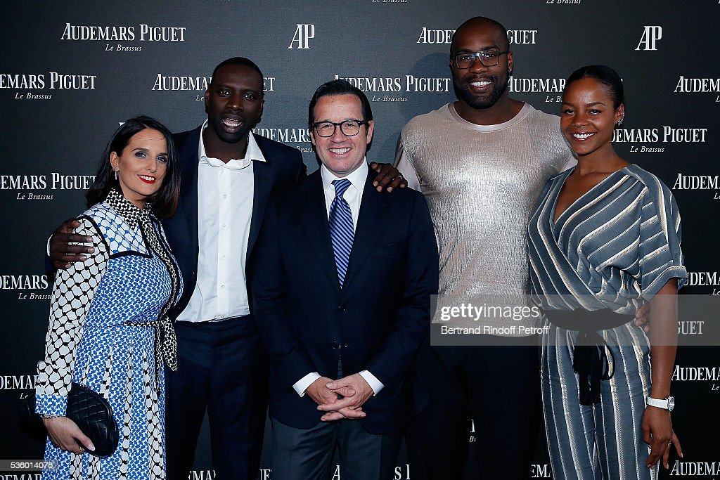 Helene Sy Omar Sy CEO of Audemars Piguet Francois Henry Bennahmias Judoka Teddy Riner and his wife Luthna Plocus attend the Audemars Piguet Rue...