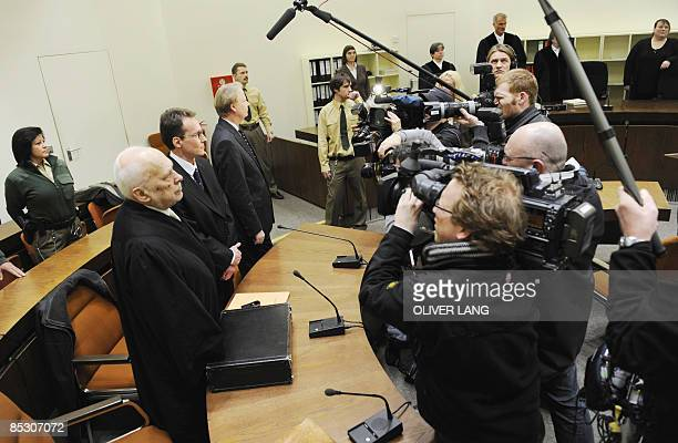 Helg Scarbi dubbed the 'Swiss Gigolo' and his lawyer Egon Geis and Till Gonterweiler face photographers and cameramen as they wait at court for the...