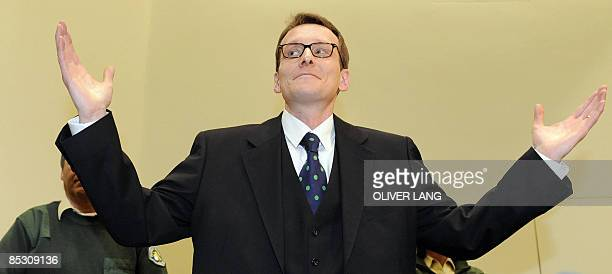 Helg Scarbi dubbed the 'Swiss Gigolo' gestures as he waits for his judgement at court during his trial on March 9 2009 in Munich southern Germany...