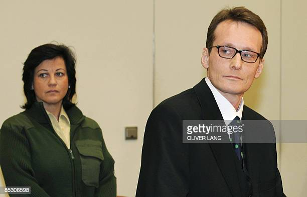 Helg Scarbi dubbed the 'Swiss Gigolo' waits at court for the start of his trial on March 9 2009 in Munich southern Germany where he is accused of...