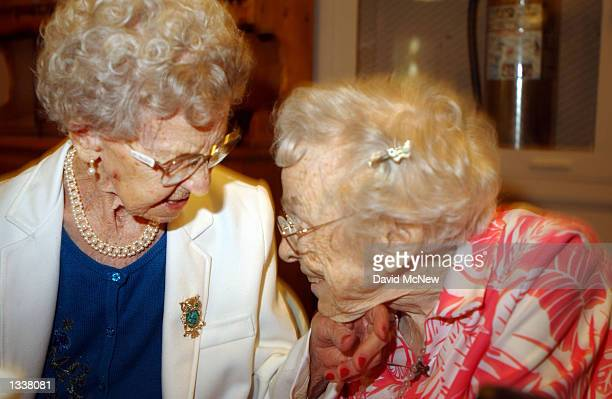 Helga Malone caresses the chin of 82yearold Ruth Brager during a birthday celebration for five women residents at the Solheim Lutheran Home who are...