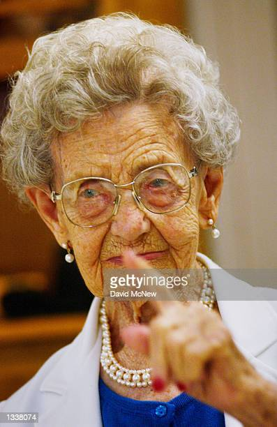 Helga Malone wags her finger at a family member trying to take her picture during a birthday celebration for five women residents at the Solheim...