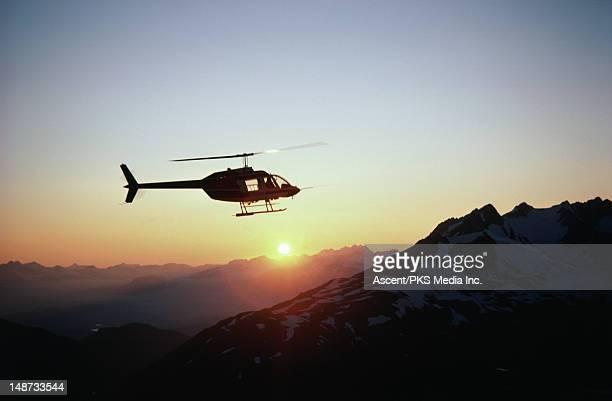 Helicoper near St Elias Mountains at sunset.