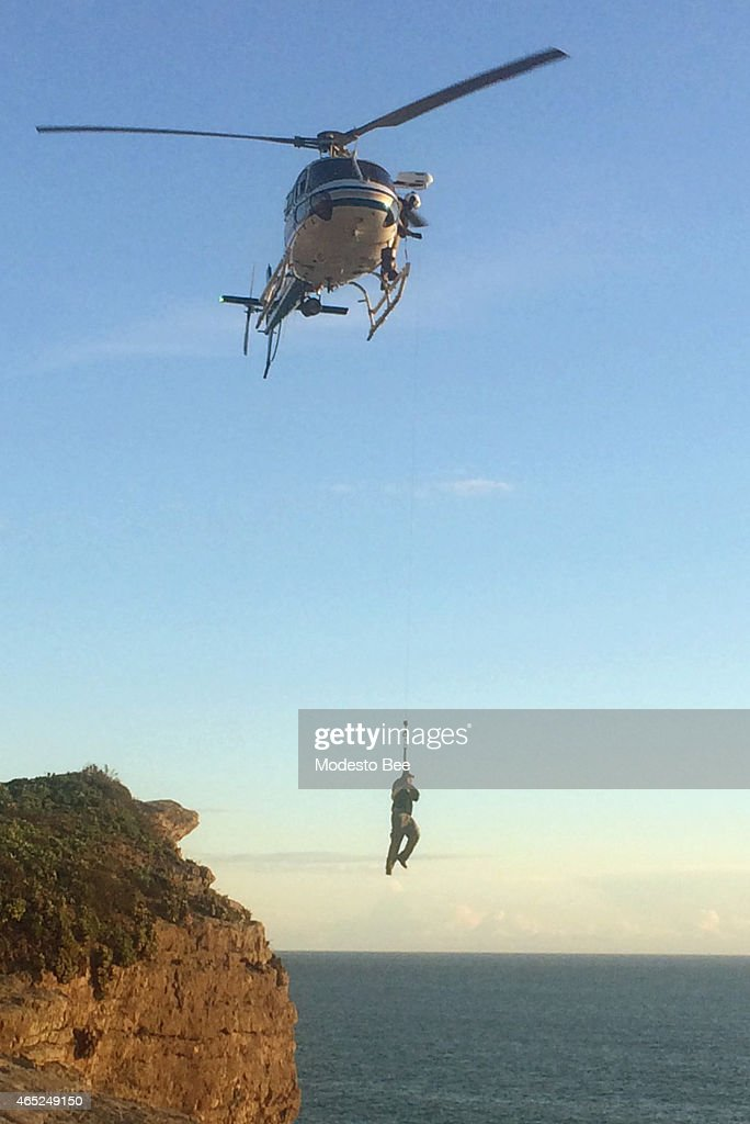A helicopter airlifts a man at Point Reyes Calif after he fell off a 70foot cliff on February 28 2015
