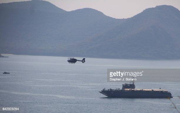 SATTAHIP CHONBURI THAILAND A helicopter and military boat approach the beach head during the ongoing USThai joint military exercise titled 'Cobra...