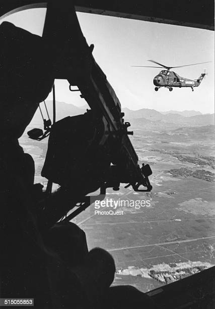 Helicopter and soldier approaching target South Vietnam 1965
