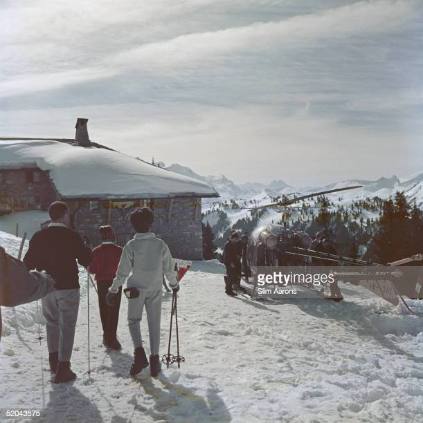 A helicopter arrives at a mountaintop resort in Gstaad 1961