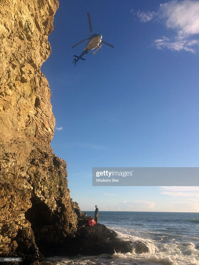 A helicopter arrives to airlift a man at Point Reyes Calif after he fell off a 70foot cliff on February 28 2015