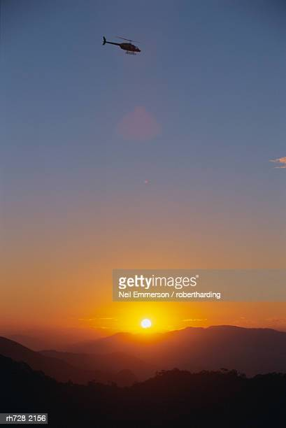 Helicopter at sunset over Rio de Janeiro, Brazil, South America