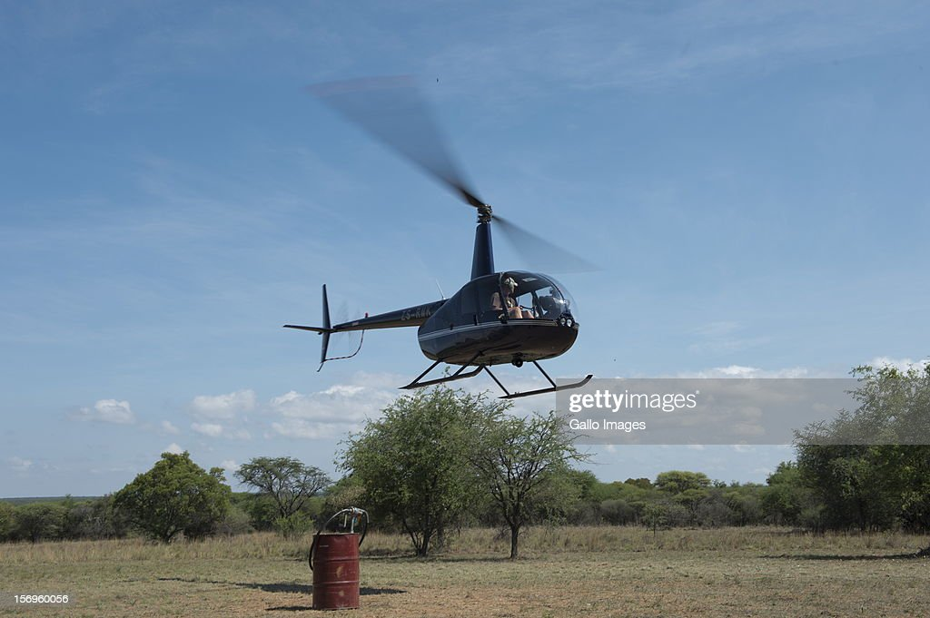 A helicopter at the Finfoot Lake Reserve on November 24, 2012 in North West, South Africa. Eight rhino were slaughtered by poachers on the farm.