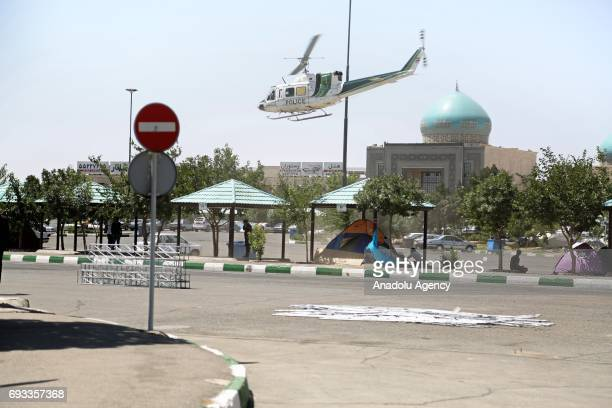 A helicopter belongs to Iranian police patrols at the site after gunmen opened fire at Irans parliament and the shrine of Ayatollah Khomeini in the...