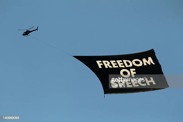 A helicopter carries a banner reading 'Freedom of Speech' before the round 23 ALeague match between the Newcastle Jets and Gold Coast United at...