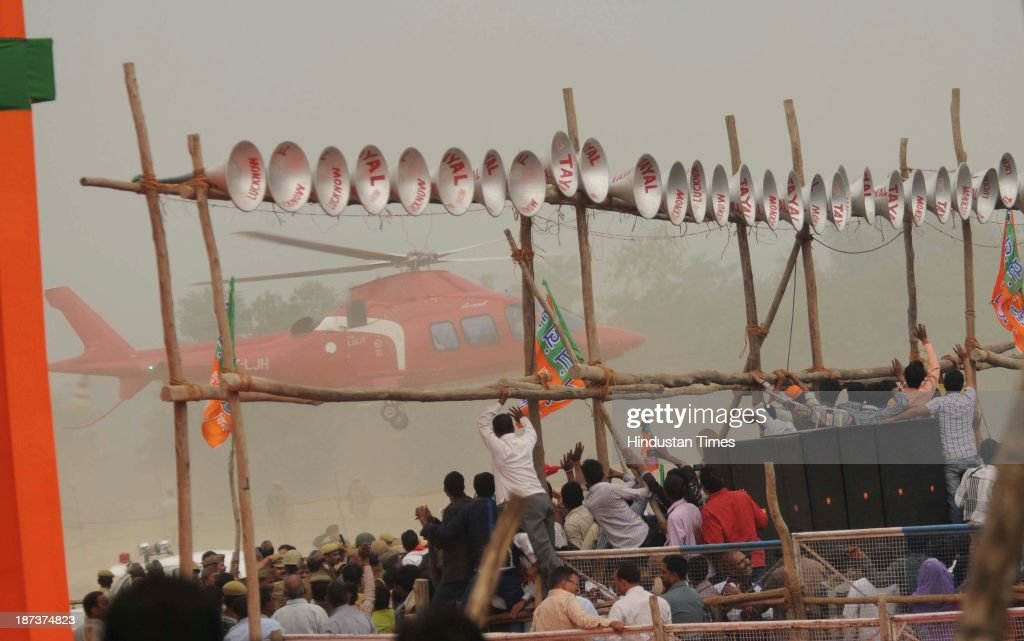 Helicopter carrying BJP prime ministerial candidate Narendra Modi arrives at the rally at Begumpur Sohrawa village on November 8, 2013 in Bahraich, India. In a hard-hitting attack on the Congress, Bahujan Samaj Party and Samajwadi Party at a rally here, Modi said the three parties had similar DNA, and urged people of Uttar Pradesh to give a decisive mandate to the BJP in the 2014 Lok Sabha polls.