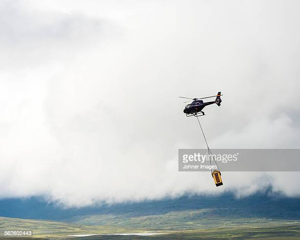 Helicopter carrying load