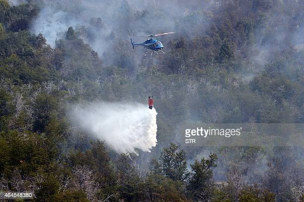 A helicopter combats fire in Cholila Chubut province Argentina on February 24 2015 A native forest was devastated by a fire that already ravaged more...