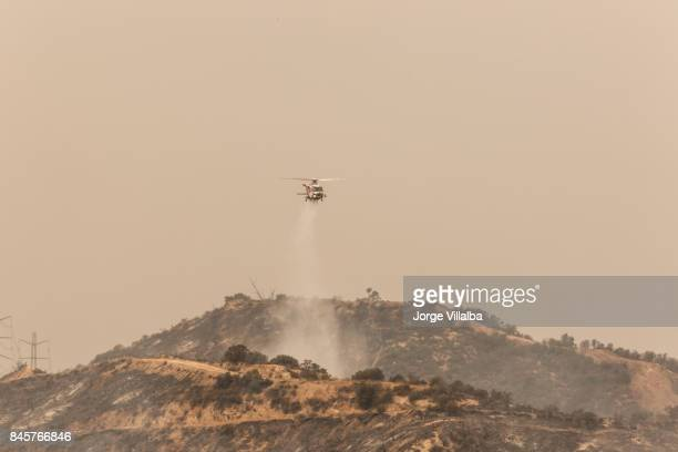 Helicopter doing drops of water on the La Tuna wildfire in Los Angeles