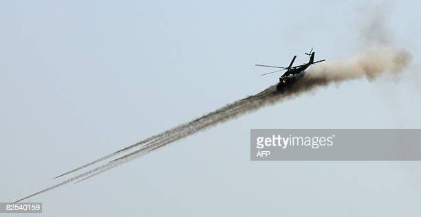 A helicopter fires munitions during a RussiaArmenia joint military exercise of the Collective Security Treaty Organization outside Armavir on August...