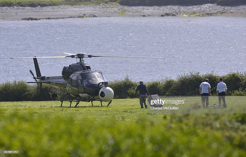 A helicopter fitted with an IMAX camera system lands to reload at the Star Wars unit location base as it continues filmingon July 30, 2014 in Skellig island, Ireland.