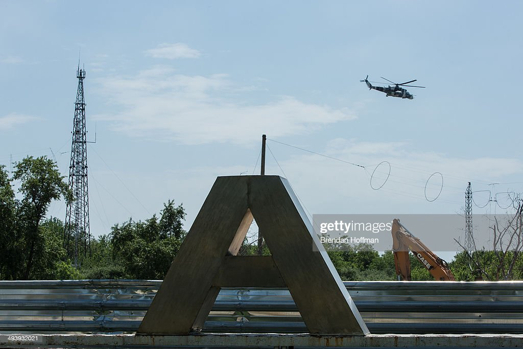 A helicopter flies low over the Donetsk airport the scene of an hourslong battle between proRussian separatists and Ukrainian forces on May 26 2014...