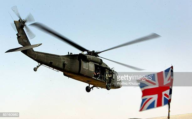 A helicopter flies near a British flag during a staff qualification course at the Iraqi Military Academy in Ar Rustimayah on October 7 2008 east of...