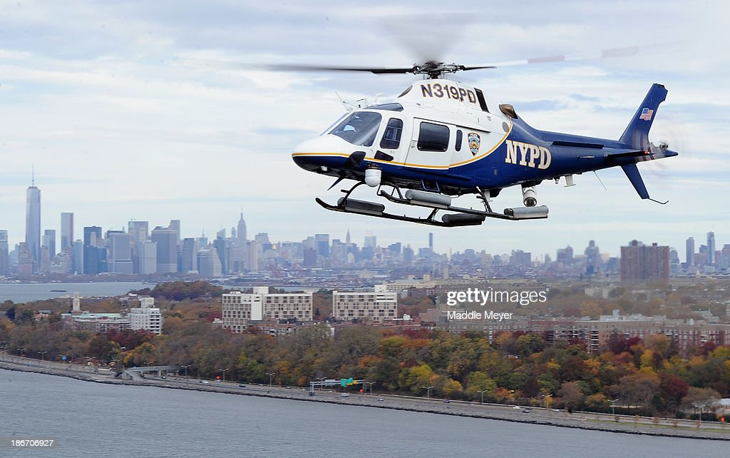 NYPD helicopter flies next the VerrazanoNarrows Bridge before the start of the ING New York City Marathon on November 3 2013 in the Brooklyn borough...