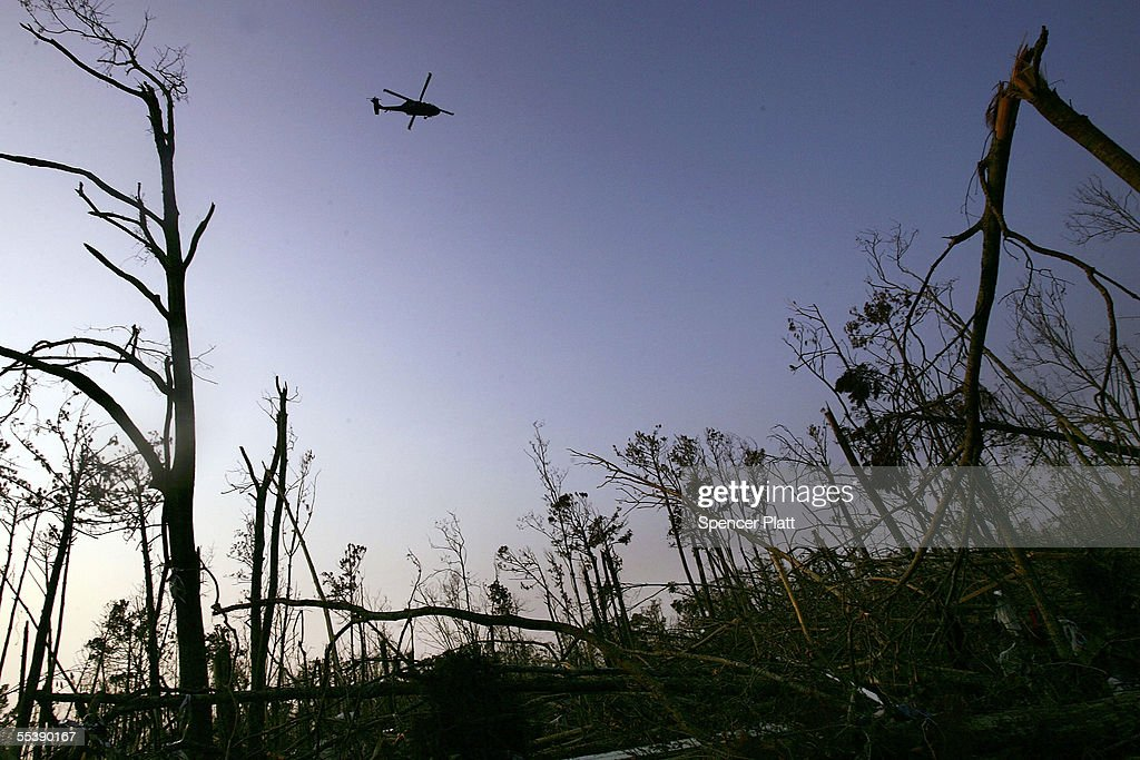 A helicopter flies over debris from Hurricane Katrina September 12 2005 in Waveland Mississippi Thousands of residents of the Gulf Coast are still...