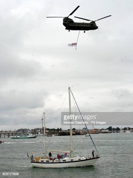 A helicopter flies over one of the boats in the Sail 8 Flotilla as it arrives in Portsmouth A tiny band of boats today sailed into the port after...