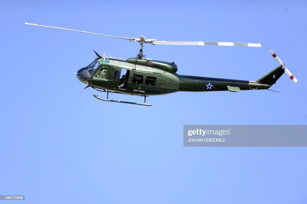 A helicopter flies over the maximum security prison Fraijanes II, located 36 km west of Guatemala City, after riots on November 19, 2012. Eigth guards of the prison are being held hostage by the inmates. AFP PHOTO/Johan ORDONEZ