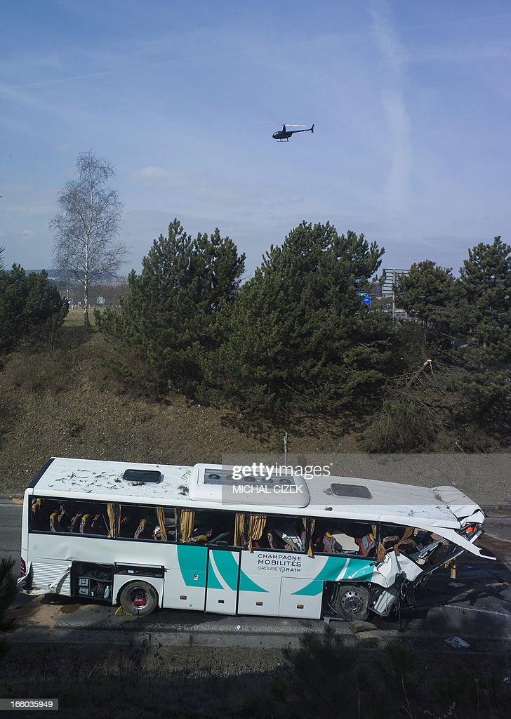 A helicopter flies over the site where a bus of French transportation company RATP crashed on highway D5 near Rokycany, Czech Republic, on April 08, 2013. 41 passengers were injured, one mortally, in the accident of a French bus on its way to Prague.