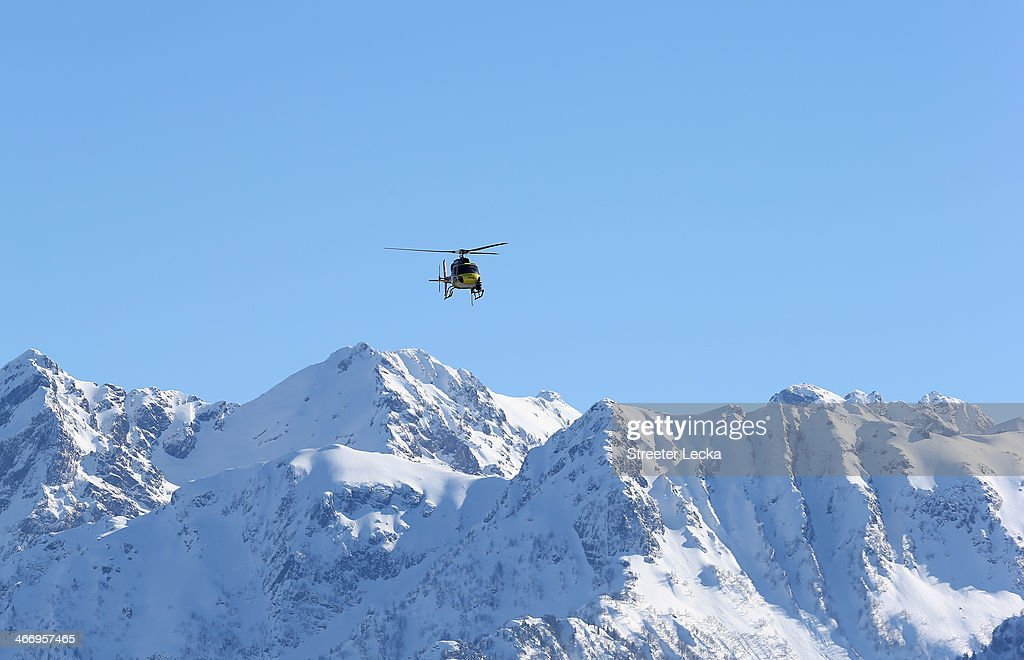 A helicopter flies over the Ski Slopestyle practice at the Extreme Park at Rosa Khutor Mountain ahead of the Sochi 2014 Winter Olympics on February 5, 2014 in Sochi, Russia.