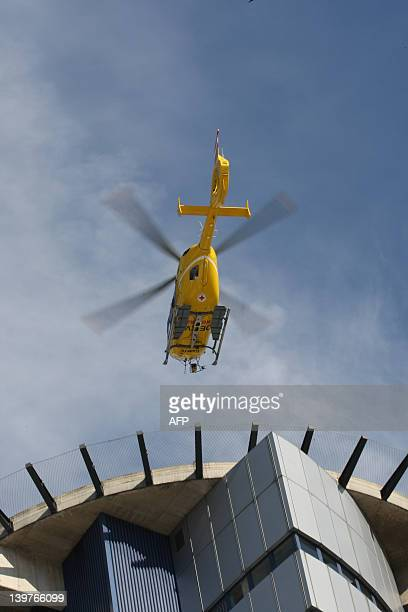 A helicopter flies over the University Hospital in Innsbruck on February 24 where Prince Johan Friso son of Dutch Queen Beatrix is staying after...