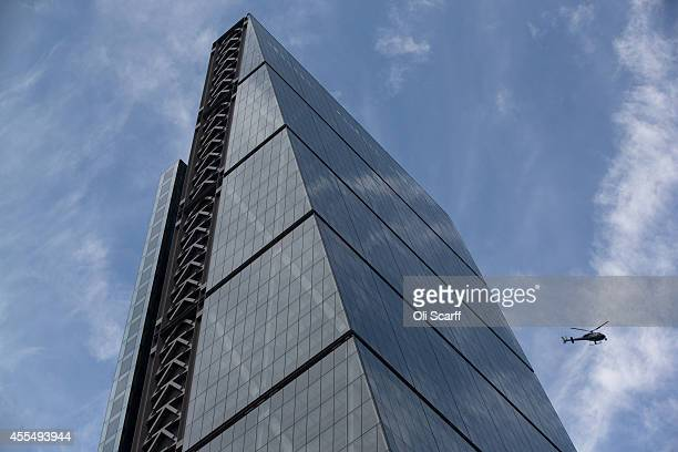 A helicopter flies past the newly constructed skyscraper The Leadenhall Building on September 15 2014 in London England The skyscraper located in the...