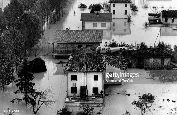 A helicopter flying over an area struck by the flood of the Arno River Florence November 1966